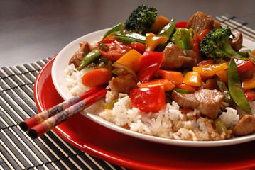 asian pork stir fry with chop sticks