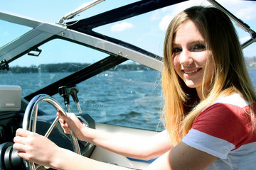 teenager driving boat