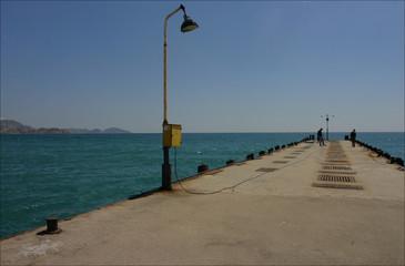 empty seashore before summer season