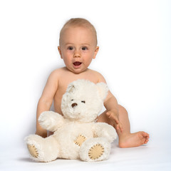 cute infant with teddy bear