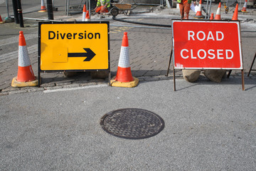 British road closed and diversion signs.