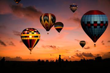 Balloon race at sunrise