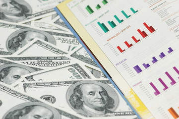 business  bar charts and hundred dollar notes