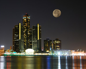 city skyline under moonlight