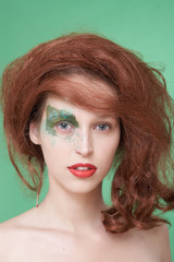 The girl with an original make-up and a red wig.