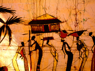 African art batik wall decoration with people and a hut.