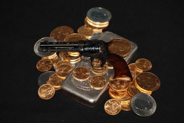 gold, silver and guns