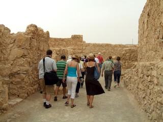 group of tourists visiting massada/ israel