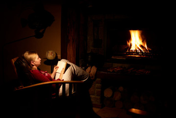 blonde woman infront of the fireplace.