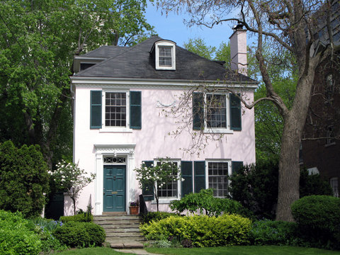 pink stucco house with shady garden