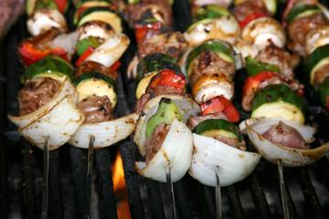 Spoed Fotobehang Voorgerecht bbq sticks on the grill