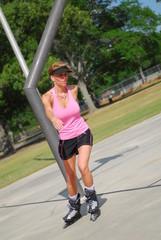 beautiful woman rollerblading