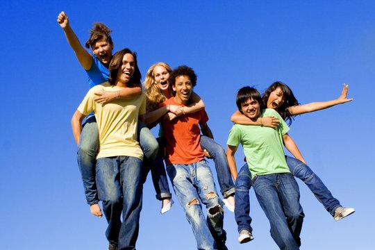 happy youth group, piggyback fun