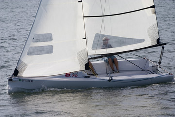 single sailboat tacking in the wind