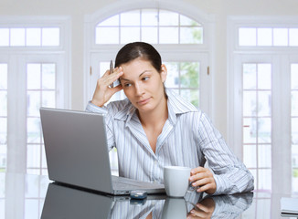 thinking woman with laptop