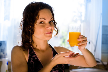 young attractive woman with a glass of fresh juice