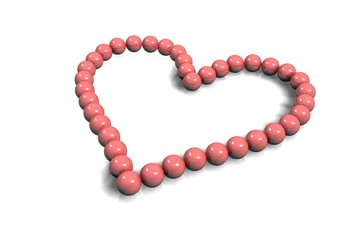 collier coeur perles roses sur fond blanc