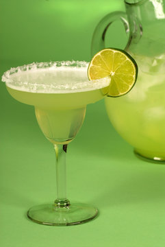 margarita with a pitcher of margaritas