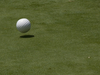 ball and shadow on green
