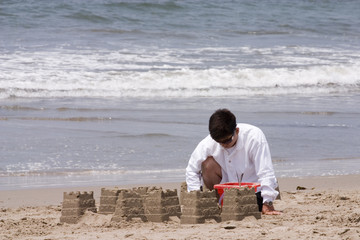 man and his sand creation