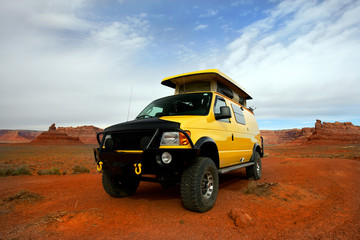 camping with yellow rv van