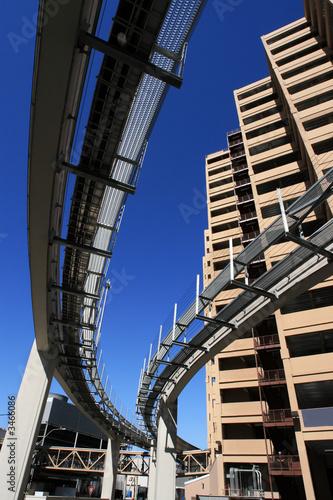 Fotobehang futuristic monorail going around skyscrapers