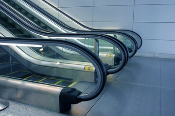escalators in futuristic airport
