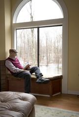 reading book at suburban house