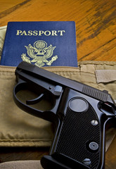 handgun with passport (vertical)