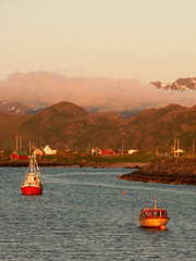 eggum's fjord at midnight with boats