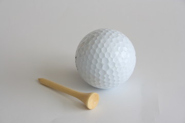 white golf ball and a tee