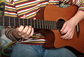 Playing on a guitar