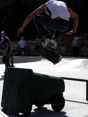 Young man demonstrating his prowess at the local skate park