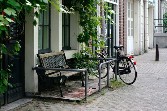Amsterdam (Netherlands), bench and front side of house.