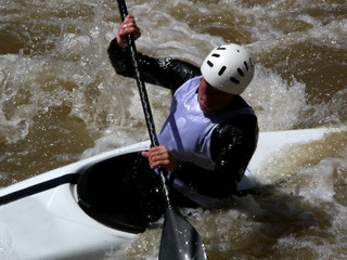 White water kayaker navigating through a rapids