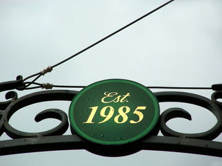 Sign above local establishment providing origination date