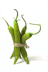 bunch of green hot chilli pepper, tied by rope