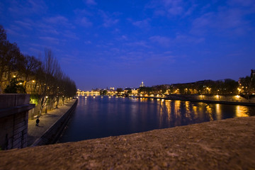 View up the Seine River at night, Paris, France