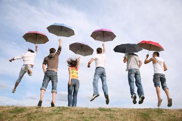 friends with umbrellas