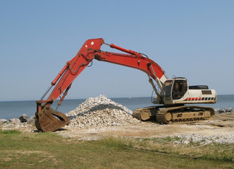 red excavator - coastal bulkhead at point lookout, maryland usa