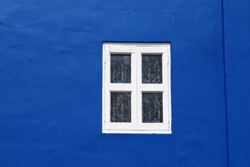 white window and blue walls
