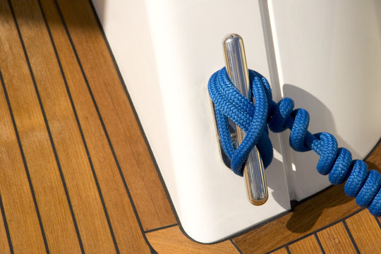 Cleat and Blue Line on Teak Deck