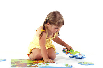 Young girl and puzzles