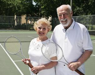 senior couple on the tennis courts.