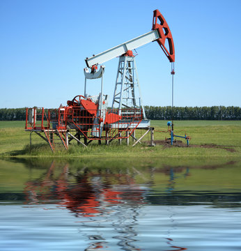 Oil Pump Jack near a sea