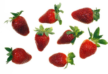Fresh and tasty strawberries reflected on white background