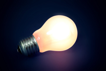 Background with lit lightbulb