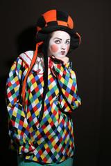 girl with clown makeup in funcy heat