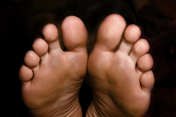 pair of feet on the black background