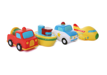 Colorful toy airplane, boat, fire truck, and police car
